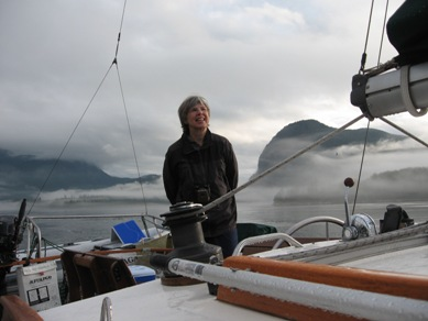 Photo: Marge Abbott pilots a sailboat in British Columbia